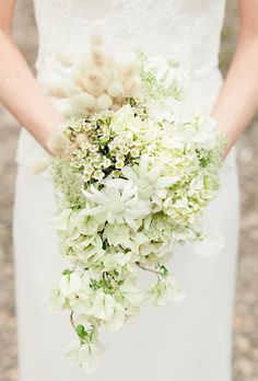 Brides.com: . A romantic cascading bouquet comprised of Queen Anne's lace, hydrangea, bougainvillea, and pussy-willow grass created by Melbourne, Australia-based florist Wunderplant.