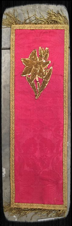From France, 19th century, red silk damask runner with gilt trim and embroidery, $65.  Gaslamp Antiques Too, booth B108.