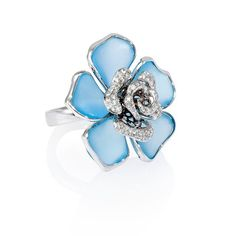 Rosamaria G Frangini | High Blue Jewellery | 18k white High Jewellery | Blue flower ring features 5 specially cut frosted blue topaz stones, weighing 16.35 carats total and round brilliant cut white diamonds of F color, VS2 clarity, weighing .45 carat total.