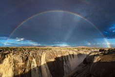 IN AWE Augrabies Waterfall, Northern Cape Afternoon sunlight paints a massive rainbow in a rainstorm falling over an already flooding Augrabies falls. Augrabies Falls, Sa Tourism, Dark Backgrounds, Countries Of The World, Landscape Photographers, Beautiful Landscapes, Decir No, South Africa, National Parks