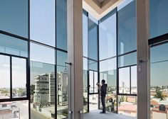 Black glazing wraps one corner of a Mexican apartment block