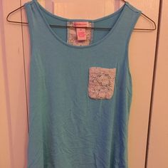 Blue tank top This is a super cute blue and white tank top! It fits as a youth XL DESIGN history  Tops Tank Tops