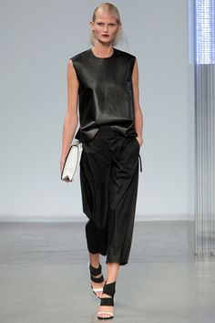 """Slouchy"" might the word of this year's New York Fashion Week. Here, a boxy, bonded leather top half-tucks into an ultra-relaxed, ultra-light pant at Helmut Lang for a no-fuss, easy-cool look. #helmutlang #nyfw #spring2014"