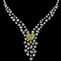 FRED reinvents Julia Roberts' necklace from Pretty Woman! At the time, a wreath of heart-shaped rubellites entwined with diamondss; today it's a cascade of diamonds of all sizes: heart-shaped and shiny, which surround an exceptional 15.80 carat yellow diamond.  Pretty Coeur offers a perfect symetry in asymetry and FRED demonstates its expertise in jewelry in this piece which lives, twirls and surprises!