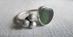 the ocean breathes salty... sea glass and silver