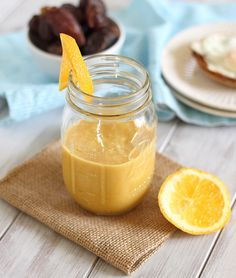 To create this creamy smoothie, blend one orange, 2 tblsp coconut cream, 1/2 cup vanilla almond milk and 2 pitted dates.