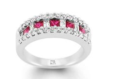 Ruby and diamond cluster eternity ring. A gorgeous collection of brilliant and emerald cut diamonds surround 5 square rubies of very fine colour and clarity. Fully hand made in 18 carat white gold in the workrooms of Charles Rose.