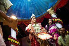 Candid wedding photography during bengali wedding ritual
