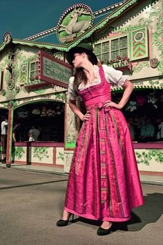 I can't decide which I like more, the building in the background or the fantastic hot pink dirndl! ;p