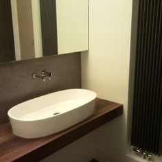 Bath with marmarino on the walls realisedby RICABO BV