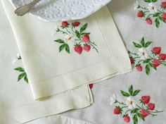 Table linens with strawberry embroidery