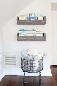 Rustic, vintage details in this nursery - we love the DIY'd bookshelves!