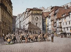 A designated World Heritage Site by UNESCO, Porto's Praça da Ribeira has been a central trading point since the middle ages. Now home to restaurants and tourists, a more agricultural scene was captured circa 1903