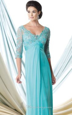 If you are looking for a simple yet elegant gown then this V-neck evening gown by Mon Cheri Montage 29980 is the perfect choice. The gown features a beaded lace bodice, a three-quarter length sleeves and a deep V-neckline. This iridescent silk chiffon gown has front draping and flares from the figure flattering ruched empire waistline to a gorgeous skirt that extends to the floor. For the finishing touch, the A-line skirt has a sweeping train.