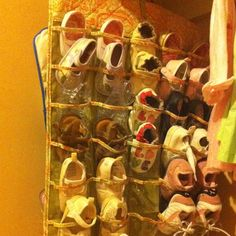 A hanging jewelry organizer as a baby girl's shoe organizer.