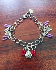 Silver Butterfly and Rose Charm Bracelet by RedSilentWolfJewelry