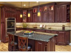 Marquette Cabinets In Sunset Cherry Warm Up The Tile Backsplash - Kitchen ideas with cherry wood cabinets