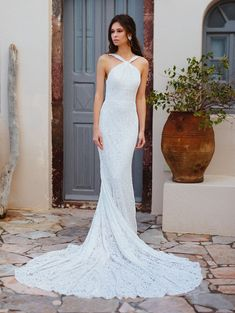 25011 - Kennedy - Looking for back drama? Look no further! This will make him say WOW! Try this beauty on at Aurora Bridal in Melbourne, FL (321)254-3880