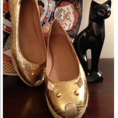 HOST PICK! Marc by Marc Jacobs mouse flats Adorable gold crinkle patent leather mouse shoes features a flat rubber sole and rope trim. You will smile every time you slip the shoes on as you see the gold leather ears and adorable little nose with whiskers. Buttery soft leather interior. Brand-new with tags! Retail $248 Marc by Marc Jacobs Shoes Flats & Loafers