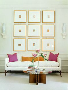 Don't necessarily like these prints, but like the idea of a collection of small, framed prints over a couch
