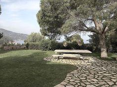 Oak table ~ floating over Rock ~ under pine Tree designed by @moredesign.es