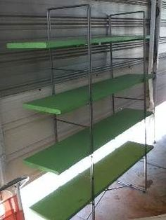 love these green and metal shelves, would look great filled with all my books and antique cameras :) Free Standing Shelves, Antique Cameras, Metal Shelves, Shop Ideas, Blinds, New Homes, Curtains, Antiques, Green