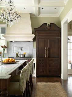 Federal Style Kitchen.  I love how the designer has incorporated the feeling of furniture in this space in the form of this custom refrigerator.  The pediment and the dark wood is very attractive.