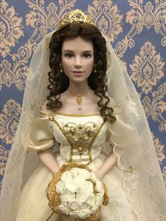"""Alexandra, The Faberge Winter Bride Doll  by the """"House of Faberge """", A breathtaking bride doll. inspired the leg-end, beauties of Russia's Imperial Court. Sculptered infine porcelain  with her exquisite features painted by hand.  nominee DOTY OF 2001. Approx. 19""""( cm 48)"""
