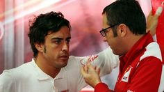 Fernando Alonso (Left) talks with Ferrari Team Principal Stefano Domenicali. (Right)