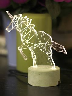 Beautiful modern unicorn lamp, laser engraved woodland themed decorative lamp. Add modern simplicity and humour to your house or office with this handmade unicorn lamp. Comes with a grey concrete base