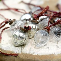 Set of 12 Nkuku Dew Drop Silver & Clear Glass Baubles with sari tie for hanging. Stunning recycled glass christmas baubles for the tree or your home Glass Christmas Baubles, Noel Christmas, All Things Christmas, Christmas Bulbs, Christmas Decorations, Christmas Ideas, Glass Ornaments, Vintage Decorations, Silver Ornaments