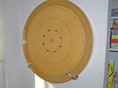 "Game room decorating idea--curtain ""hold backs"" to store a crokinole board. Been looking for hanging gear. Wonder how steady they hold the board. Crokinole Board, Boards, Board Game Storage, Wood Games, Game Room Decor, Woodworking, Display, Cool Stuff, Basement"