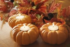 Harvest tea lights center piece. Just pop a votive candle in the top of a small pumpkin.