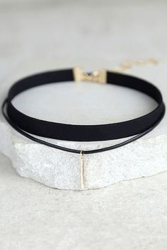 """The Sweetness Black and Gold Layered Choker Necklace is just like you, effortlessly chic! A black cord, accented with a shiny gold charm, joins a skinny black band to create this simple choker necklace. Shortest necklace measures 11"""" around with a 2.5"""" extender chain."""