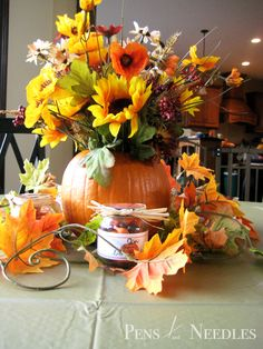 fall baby shower ideas   To add some interest to these centerpieces, I found leafy autum ...