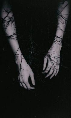 vines wapping around her.