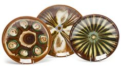 """Set of 3 red clay decorative plates, 1960s. Cooperative """"Kamionka"""" in Lysa Gora, Poland. Sold at auction 2016."""