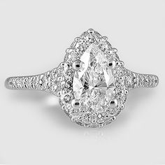 18K White Gold Circa Diamond Ring // Set with a 0.70 Carat, Pear, Ideal Cut, D Color, VVS2 Clarity Diamond #BrilliantEarth