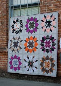 Quilt with Halloween Colors, Hanging on Brick Wall