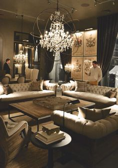 I like the 3 sofa look in this room with a big square table in the middle this would be fab for our great room Restoration Hardware Opening Boston
