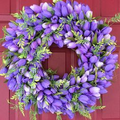 Full tulip wreaths are super popular this Spring. Classic & bright.   Cathy Miller, the designer of this lovely, is the winner of this week's Show & Tell Tuesday. If you want to join us next Tuesday hop over to my Facebook business page at https://www.facebook.com/nancyladybugwreaths/