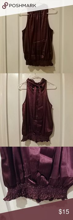 "Forever 21 burgundy halter top Halter top with tie on back neck line. Elastic waist.  Length 24"". 97%Poly 3%spandex. Slightly worn. Forever 21 Tops Blouses"
