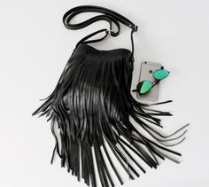 The style  Made from a beautiful midnight black full grain leather, this is thick, soft and supple; specifically designed for daily wear and tear; quality of the finest. Two layers of hand cut fringe across the front of this sassy little crossbody boho bag add a wonderful sway when you move. The details  - Measures 10 long by 9 wide, with the fringe adding another 5 to the total length of the bag  - This is lined with a beautiful midnight black caviar cotton lining. - Leather adjustable 50…