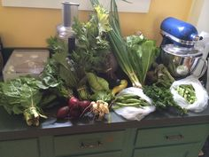 Week 3 - July 8, 2014: Beets, Scallions, Kale, Snap peas, Fava beans, Zucchini, Summer Squash, Green Cone Cabbage, Hakurei Turnips, Mustard Greens, Green Romaine, Red Romaine, White Chard and Curly Parsley.  I washed and spun: Kale, Mustard Greens, Beet Greens, Turnip Greens, Romaine, Chard and Parsley.   I stored unwashed: Beets, Scallions, Peas, Beans, Squash, Cabbage and Turnips.