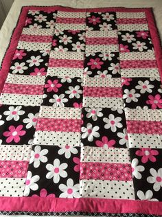 This is a machine sewn pretty Floral inspired cotton quilt/throw.Floral quilt, flowers, baby blanket, baby quilt, Michael Miller fabric by Ladylovesfabric on Etsy It measures 41 by 58 inches.for idea i may use recycled girls boys clothes.Gina and Mal Baby Girl Quilts, Boy Quilts, Girls Quilts, Baby Quilts Easy, Quilts For Kids, Quilt Baby, Flannel Quilts, Amish Quilts, Star Quilts