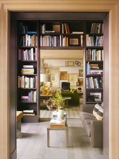 small hallway library nook... love this use of space!! How about shook case that extends floor to ceiling by the top of the stairs then though the doorway nd down the stairs ?