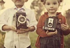 Focus on cameras and cut off ... Early moments in photography!