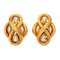 VAN CLEEF & ARPELS Gold and Diamond Ear Clips,of 18K gold rope, looped around diamond sections. Circa 1970s