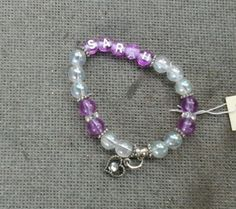 Pre made bracelet I sold this summer.  Csn be found under purple letter listing for $9.50