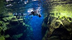 snorkeling between two tectonic plates, separating America from Eurasia in IcelandI!!  ION Iceland (First adventure hotel)